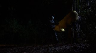 Jason kills a girl in a sleeping bag by slamming it against a tree