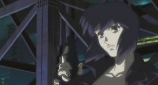 Major Kusanagi stands atop a skyscraper